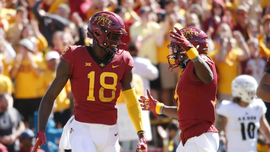 AMES, IA - SEPTEMBER 22: Wide receiver Hakeem Butler #18 of the Iowa State Cyclones celebrates with teammate wide receiver Deshaunte Jones #8 of the Iowa State Cyclones after scoring a touchdown in the first half of play at Jack Trice Stadium on September 22, 2018 in Ames, Iowa. The Iowa State Cyclones won 26-13 over the Akron Zips. (Photo by David K Purdy/Getty Images)