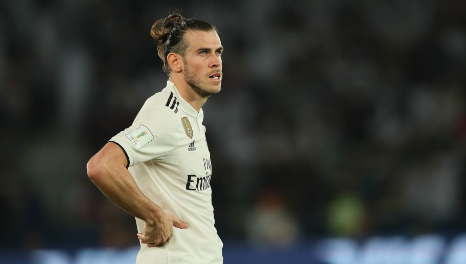ABU DHABI, UNITED ARAB EMIRATES - DECEMBER 22: Gareth Bale of Real Madrid in action during the FIFA Club World Cup UAE final match between  Real Madrid and Al Ain at Sheikh Zayed Stadium on December 22, 2018 in Abu Dhabi, United Arab Emirates. (Photo by Matthew Ashton - AMA/Getty Images)
