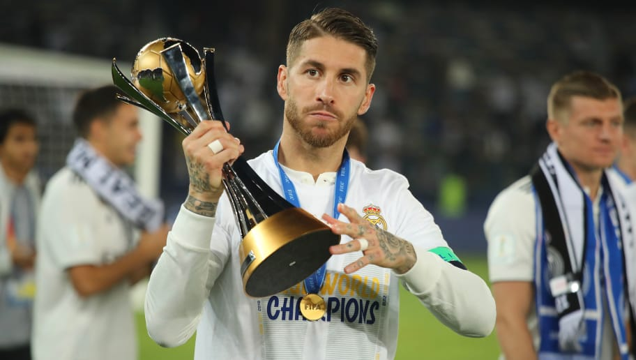 ABU DHABI, UNITED ARAB EMIRATES - DECEMBER 22:  Sergio Ramos of Real Madrid celebrates with the FIFA Club World Cup trophy at the end of the FIFA Club World Cup UAE final match between Real Madrid and Al Ain at Sheikh Zayed Stadium on December 22, 2018 in Abu Dhabi, United Arab Emirates. (Photo by Matthew Ashton - AMA/Getty Images)