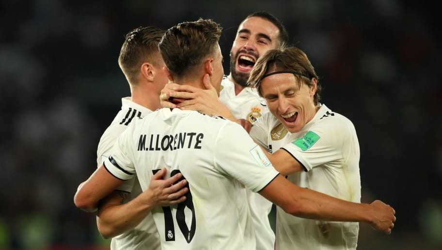 ABU DHABI, UNITED ARAB EMIRATES - DECEMBER 22:   Marcos Llorente of Real Madrid celebrates scoring a goal to make it 2-0 with Luka Modric and his team-mates during the FIFA Club World Cup UAE final match between Real Madrid and Al Ain at Sheikh Zayed Stadium on December 22, 2018 in Abu Dhabi, United Arab Emirates. (Photo by Matthew Ashton - AMA/Getty Images)