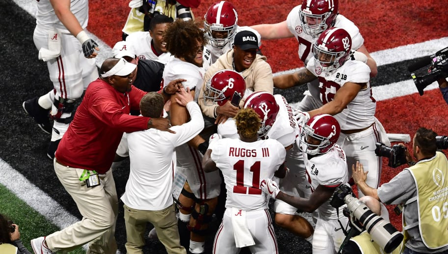 ATLANTA, GA - JANUARY 08: DeVonta Smith #6 of the Alabama Crimson Tide celebrates with teammates after making the game-winning touchdown catch in overtime to defeat the Georgia Bulldogs in the CFP National Championship presented by AT&T at Mercedes-Benz Stadium on January 8, 2018 in Atlanta, Georgia. (Photo by Scott Cunningham/Getty Images)