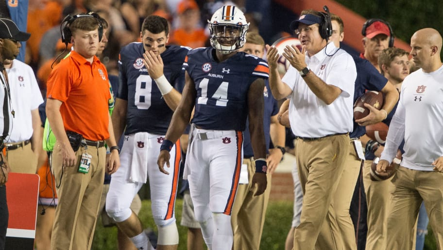 AUBURN, AL - SEPTEMBER 8: Head coach Gus Malzahn of the Auburn Tigers speaks with quarterback Malik Willis #14 of the Auburn Tigers and quarterback Jarrett Stidham #8 of the Auburn Tigers during their game against the Alabama State Hornets at Jordan-Hare Stadium on September 8, 2018 in Auburn, Alabama. (Photo by Michael Chang/Getty Images)