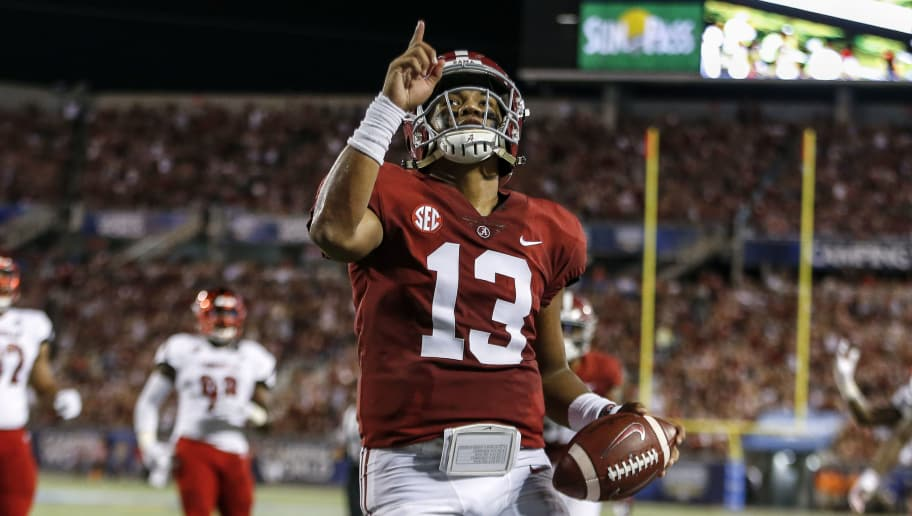 ORLANDO, FL - SEPTEMBER 1: Quarterback Tua Tagovailoa #13 of the Alabama Crimson Tide points to the sky while celebrates after a score during the game against the Louisville Cardinals during the Camping World Kickoff at Camping World Stadium on September 1, 2018 in Orlando, Florida. #1 ranked Alabama defeated Louisville 51 to 14. (Photo by Don Juan Moore/Getty Images)