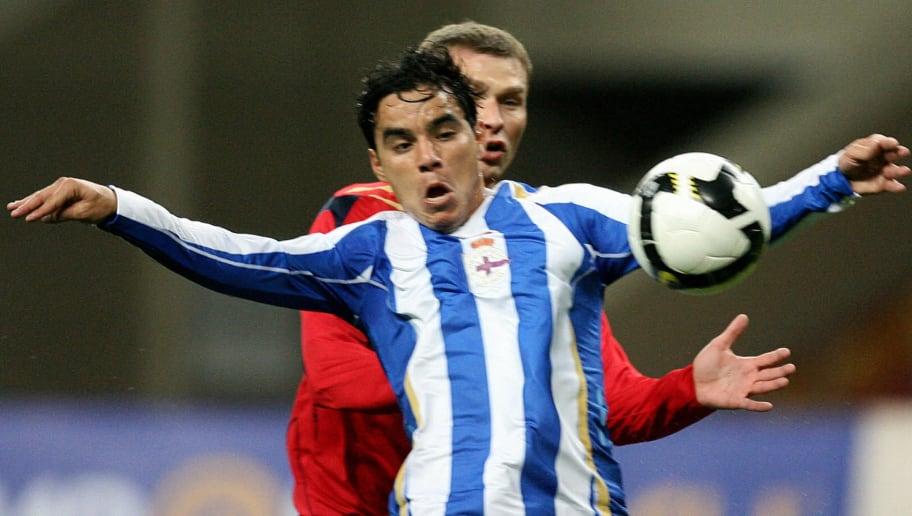Alexey Berezutsky (R) of Russia's CSKA v