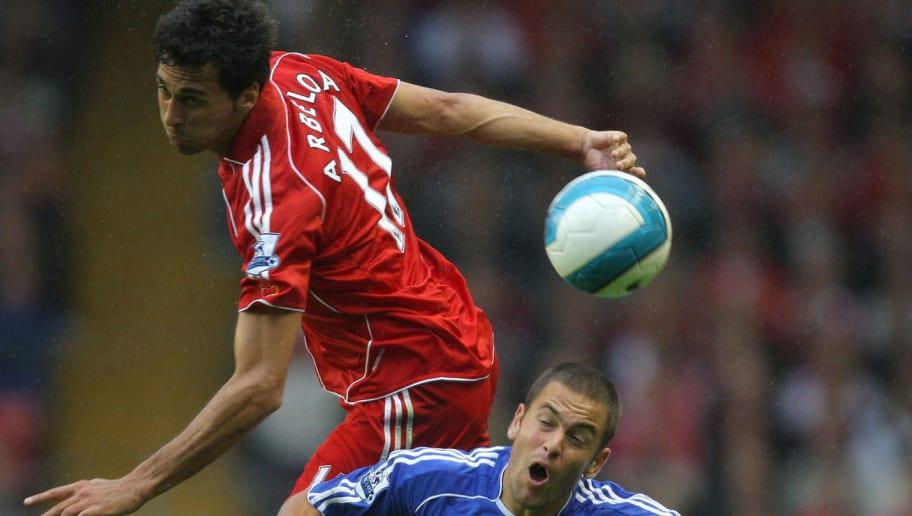 Alvaro Arbeloa (L)  of  Liverpool vies w