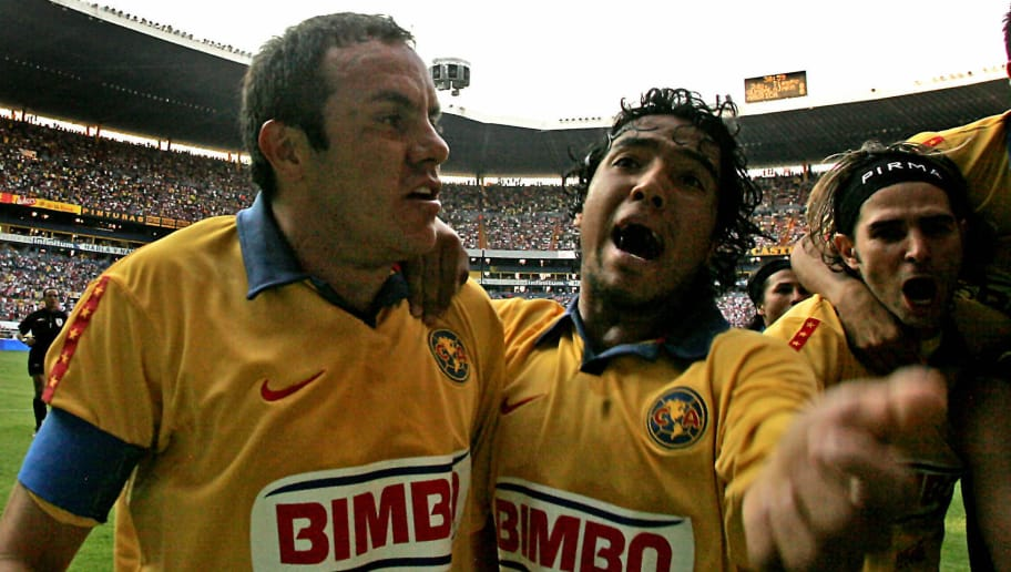 Guadalajara, MEXICO: America's Cuahutemoc Blanco (L) and teammate Juan Carlos Mosqueda celebreate their victory against Guadalajara, during their Mexican Cup' s semifinals match, 20 May 2007, in Guadalajara, Mexico.  AFP PHOTO/Luis ACOSTA (Photo credit should read LUIS ACOSTA/AFP/Getty Images)