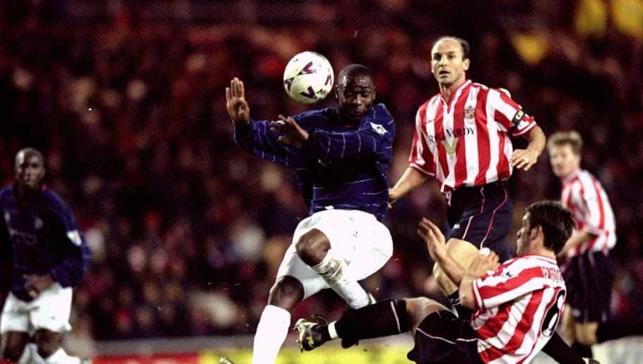 28 Dec 1999:  Andy Cole of Manchester United is challenged by Paul Butler of Sunderland during the FA Carling Premiership match at the Stadium of Light in Sunderland, England. The game ended 2-2. \ Mandatory Credit: Shaun Botterill /Allsport