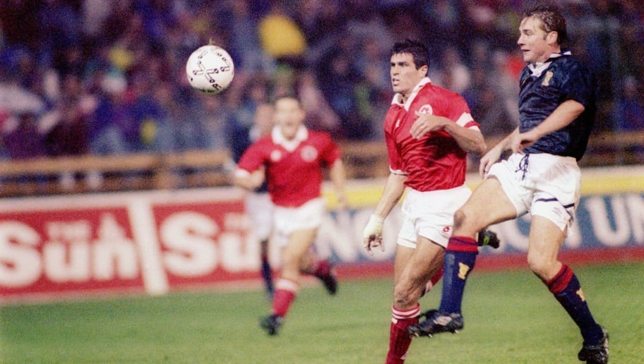 8 SEP 1993:  ANDY EGLI OF SWITZERALND RACES FOR THE BALL WITH ALLY MCCOIST OF SCOTLAND DURING THE WORLD CUP QUALIFIER IN ABERDEEN. Mandatory Credit: Ben Radford/ALLSPORT