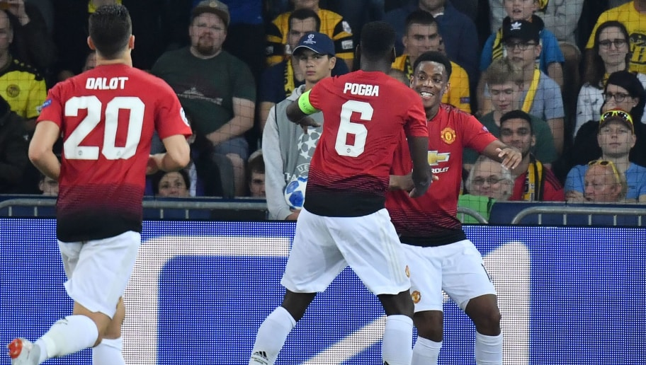 Manchester United's French striker Anthony Martial (R) celebrates with teammates Paul Pogba (C) and Diogo Dalot after scoring during the UEFA Champions League group H football match between Young Boys and Manchester United at The Stade de Suisse in Bern on September 19, 2018. (Photo by Alain GROSCLAUDE / AFP)        (Photo credit should read ALAIN GROSCLAUDE/AFP/Getty Images)