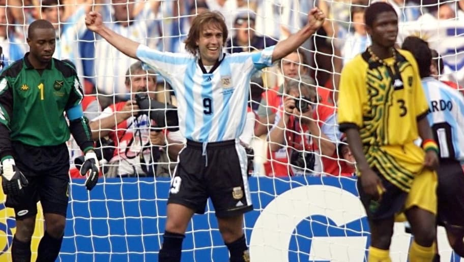 PARIS, FRANCE:  Argentina forward Gabriel Batistuta (2nd L) celebrates after scoring a goal past Jamaican goalkeeper Warren Barrett, 21 June at the Parc des Princes stadium in Paris, during the 1998 Soccer World Cup Group H first round match against Jamaica.  (ELECTRONIC IMAGE)  AFP PHOTO (Photo credit should read DANIEL GARCIA/AFP/Getty Images)