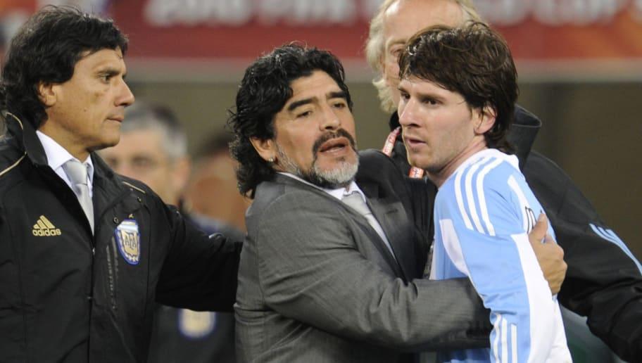 Argentina's coach Diego Maradona hugs Ar
