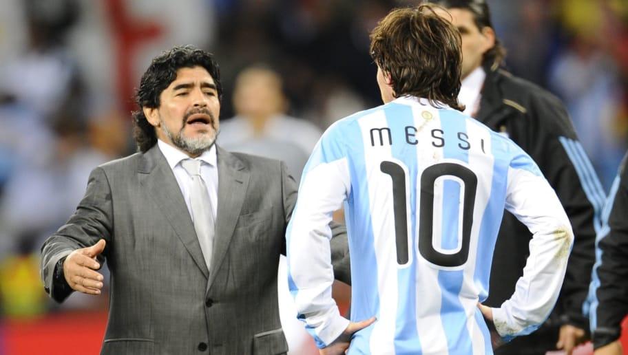 Argentina's coach Diego Maradona (L) loo
