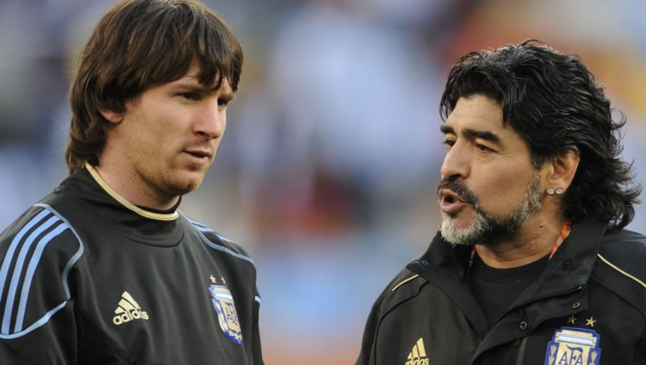 Argentina's coach Diego Maradona (R) speaks to Argentina's striker Lionel Messi prior the 2010 World Cup quarter-final match Argentina vs. Germany on July 3, 2010 at Green Point stadium in Cape Town.  NO PUSH TO MOBILE / MOBILE USE SOLELY WITHIN EDITORIAL ARTICLE -   AFP PHOTO / JAVIER SORIANO (Photo credit should read JAVIER SORIANO/AFP/Getty Images)