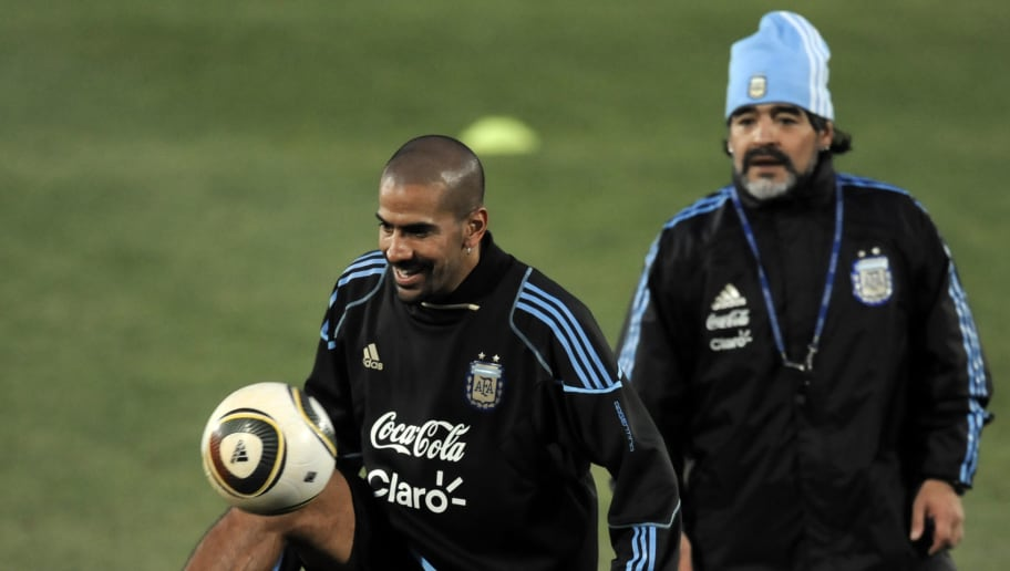 Argentina's coach Diego Maradona (R) wat