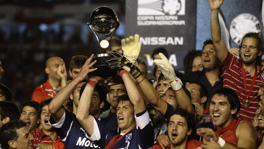 Argentina's Independiente players celebrate with the trophy after winning the Copa Sudamericana  2010 final footbal match after defeating to Brazil's Goias,  at Libertadores de America stadium, in  Buenos Aires, December 9, 2010..     AFP PHOTO/Alejandro PAGNI (Photo credit should read ALEJANDRO PAGNI/AFP/Getty Images)