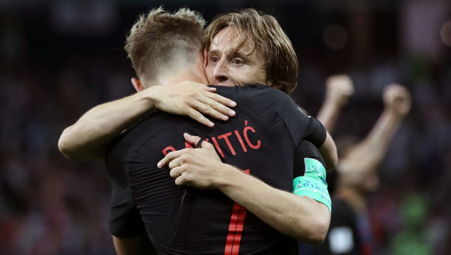NIZHNY NOVGOROD, RUSSIA - JUNE 21:  Ivan Rakitic of Croatia celebrates with teammate Luka Modric of Croatia after scoring his team's third goal during the 2018 FIFA World Cup Russia group D match between Argentina and Croatia at Nizhny Novgorod Stadium on June 21, 2018 in Nizhny Novgorod, Russia.  (Photo by Clive Brunskill/Getty Images)