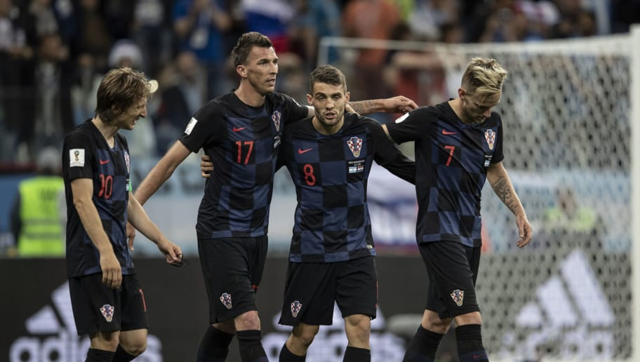 NIZHNIY NOVGOROD, RUSSIA - JUNE 21:  Mateo Kovacic (8), Ivan Rakitic (C) and Mario Mandzukic (17) of Croatia celebrate after winning the 2018 FIFA World Cup Russia Group D match against Argentina at Nizhny Novgorod Stadium in Nizhny Novgorod, Russia on June 21, 2018.  (Photo by Fred Lee/Getty Images)