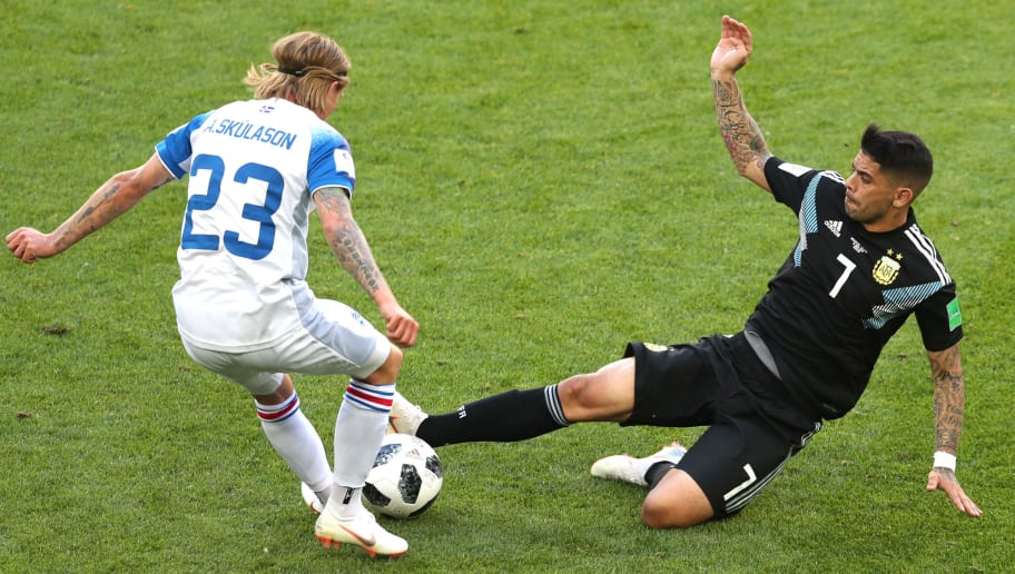 MOSCOW, RUSSIA - JUNE 16:  Ever Banega of Argentina tackles Ari Skulason of Iceland  during the 2018 FIFA World Cup Russia group D match between Argentina and Iceland at Spartak Stadium on June 16, 2018 in Moscow, Russia.  (Photo by Clive Rose/Getty Images)