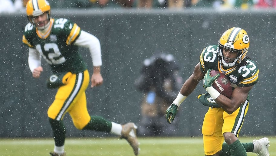 GREEN BAY, WI - DECEMBER 02:  Aaron Jones #33 of the Green Bay Packers runs with the ball during the first half of a game against the Arizona Cardinals at Lambeau Field on December 2, 2018 in Green Bay, Wisconsin.  (Photo by Stacy Revere/Getty Images)