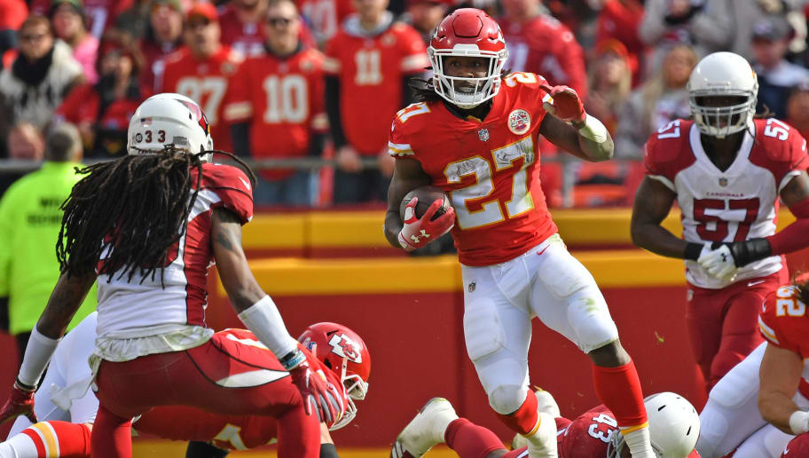 KANSAS CITY, MO - NOVEMBER 11:  Running back Kareem Hunt #27 of the Kansas City Chiefs rushes up field against defensive back Tre Boston #33 of the Arizona Cardinals during the first half on November 11, 2018 at Arrowhead Stadium in Kansas City, Missouri.  (Photo by Peter G. Aiken/Getty Images)