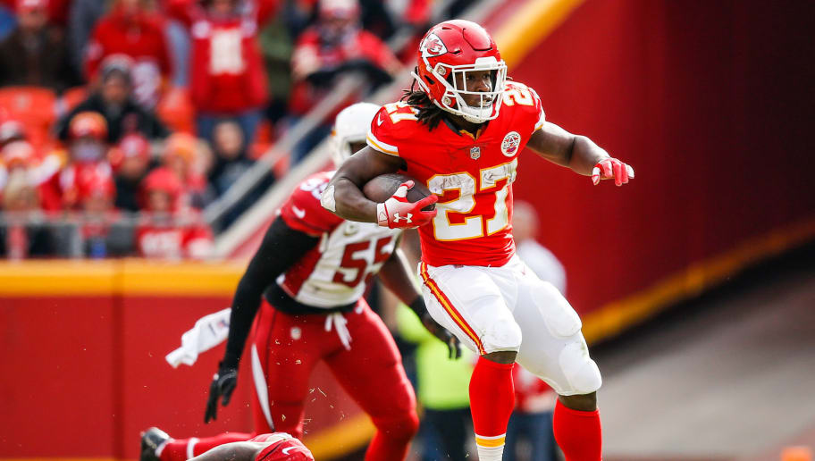 KANSAS CITY, MO - NOVEMBER 11: Kareem Hunt #27 of the Kansas City Chiefs makes a jump cut over Bene' Benwikere #23 of the Arizona Cardinals during the first half of the game at Arrowhead Stadium on November 11, 2018 in Kansas City, Missouri. (Photo by David Eulitt/Getty Images)