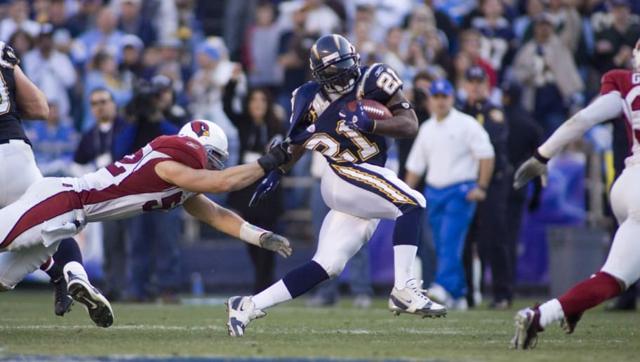 LaDainian Tomlinson Running Back For The San Diego Chargers Draggs A Defender Upfield In Game