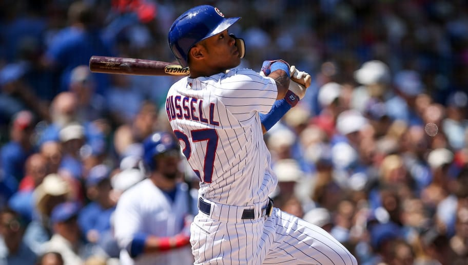 CHICAGO, IL - JULY 25:  Addison Russell #27 of the Chicago Cubs flies out in the second inning against the Arizona Diamondbacks at Wrigley Field on July 25, 2018 in Chicago, Illinois.  (Photo by Dylan Buell/Getty Images)