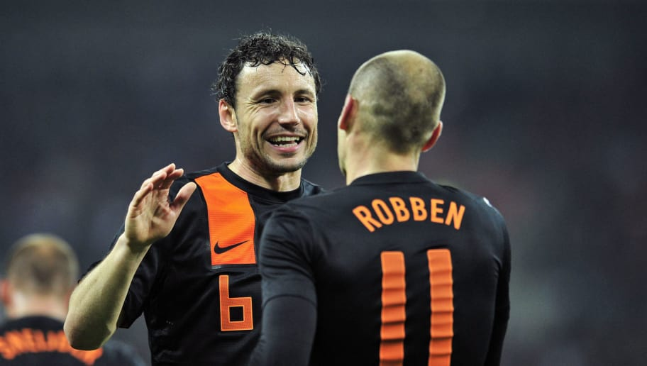 Arjen Robben (R) of The Netherlands celebrates scoring his first goal with Mark van Bommel (L) during the International friendly football match between England and The Netherlands at Wembley Stadium in London on February 29, 2012. AFP PHOTO/GLYN KIRK  NOT FOR MARKETING OR ADVERTISING USE / RESTRICTED TO EDITORIAL USE (Photo credit should read GLYN KIRK/AFP/Getty Images)