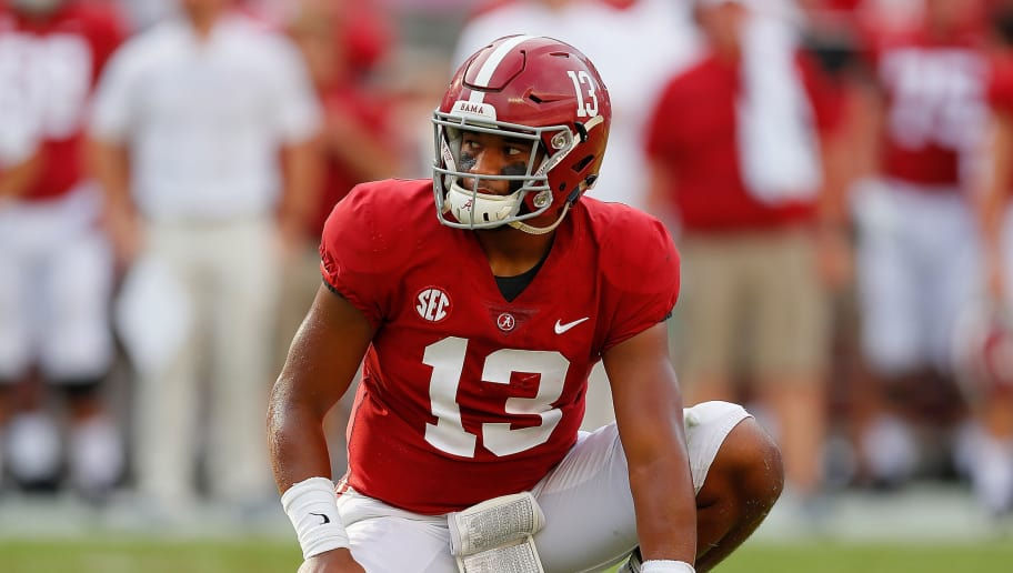 TUSCALOOSA, AL - SEPTEMBER 08:  Tua Tagovailoa #13 of the Alabama Crimson Tide waits to hold the ball for an extra point by Joseph Bulovas #97 against the Arkansas State Red Wolves at Bryant-Denny Stadium on September 8, 2018 in Tuscaloosa, Alabama.  (Photo by Kevin C. Cox/Getty Images)