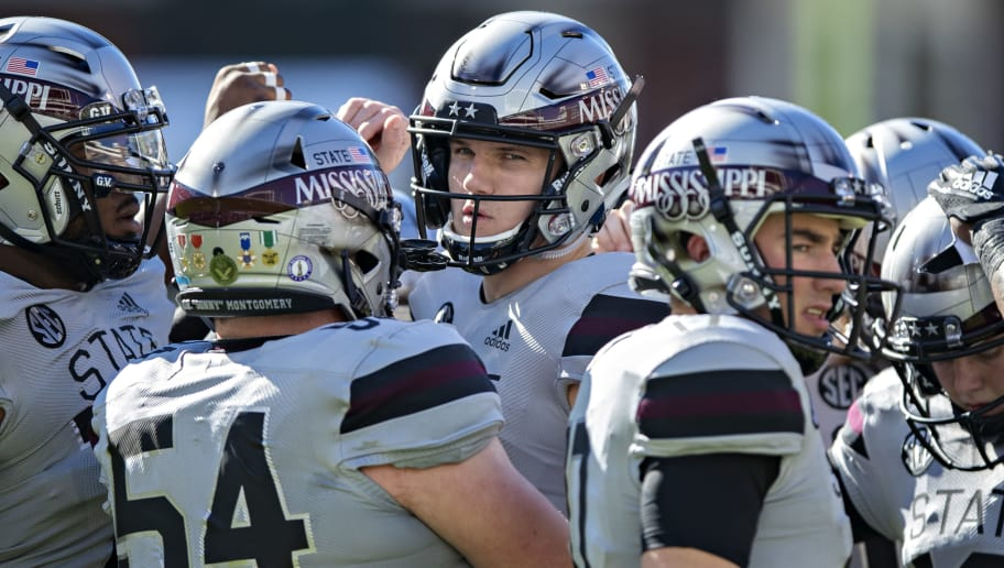 STARKVILLE, MS - NOVEMBER 17:  Nick Fitzgerald #7 of the Mississippi State Bulldogs huddles with the team before a game against the Arkansas Razorbacks at Davis Wade Stadium on November 17, 2018 in Starkville, Mississippi.  (Photo by Wesley Hitt/Getty Images)