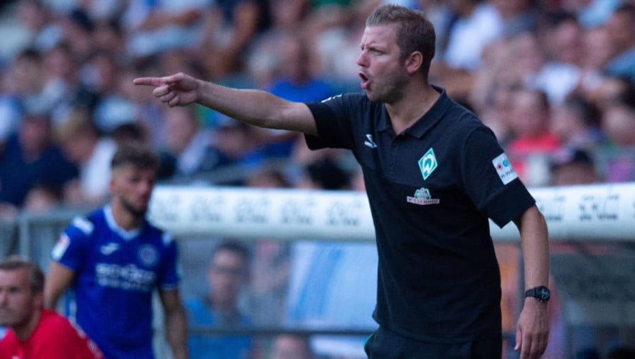 BIELEFELD, GERMANY - JULY 27: Head coach Florian Kohfeldt of Werder Bremen gestures during the Friendly match between Arminia Bielefeld and SV Werder Bremen at SchücoArena on July 27, 2018 in Bielefeld, Germany. (Photo by TF-Images/Getty Images)