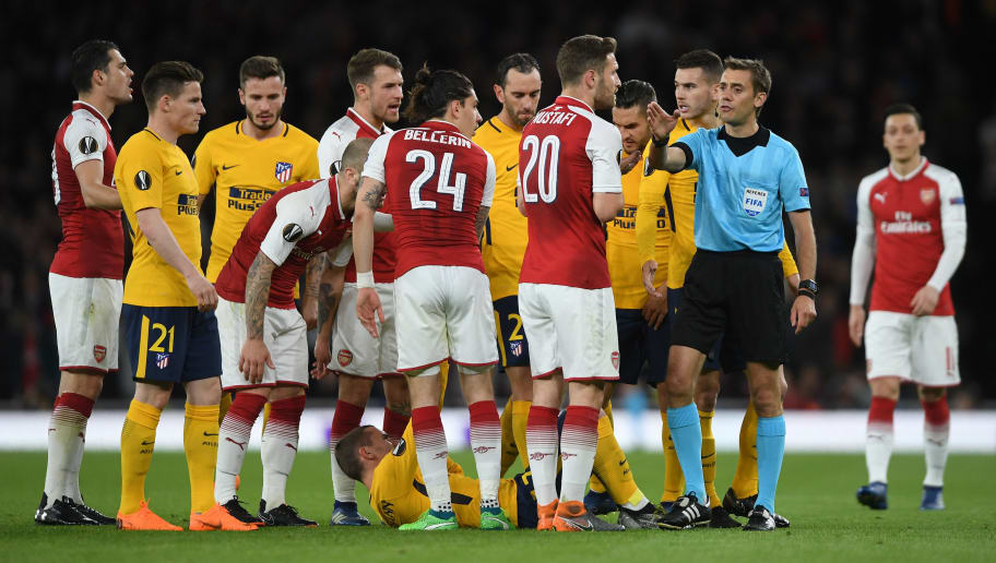 LONDON, ENGLAND - APRIL 26:  Players from both teams query a decision by referee Clement Turpin during the UEFA Europa League Semi Final leg one match between Arsenal FC and Atletico Madrid at Emirates Stadium on April 26, 2018 in London, United Kingdom.  (Photo by Mike Hewitt/Getty Images)