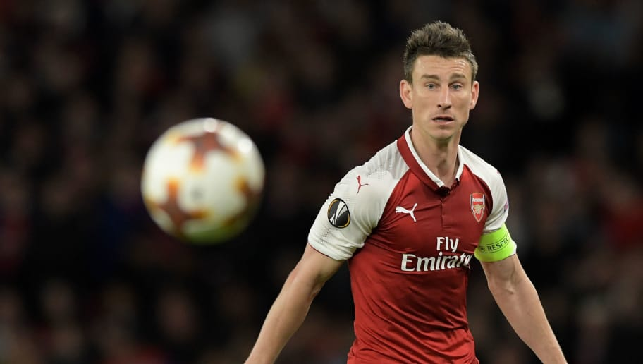 LONDON, ENGLAND - APRIL 26: Laurent Koscielny of Arsenal looks at the ball during the UEFA Europa League Semi Final leg one match between Arsenal FC and Atletico Madrid at Emirates Stadium on April 26, 2018 in London, United Kingdom. (Photo by TF-Images/Getty Images)
