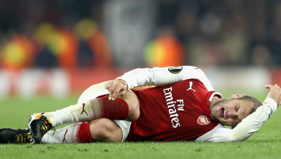 LONDON, ENGLAND - NOVEMBER 02:  Jack Wilshere of Arsenal goes down injured during the UEFA Europa League group H match between Arsenal FC and Crvena Zvezda at Emirates Stadium on November 2, 2017 in London, United Kingdom.  (Photo by Bryn Lennon/Getty Images)