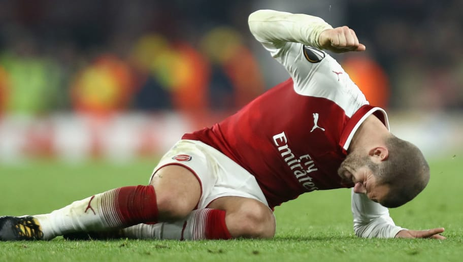 LONDON, ENGLAND - NOVEMBER 02: Jack Wilshere of Arsenal reacts to going down injured during the UEFA Europa League group H match between Arsenal FC and Crvena Zvezda at Emirates Stadium on November 2, 2017 in London, United Kingdom.  (Photo by Bryn Lennon/Getty Images)