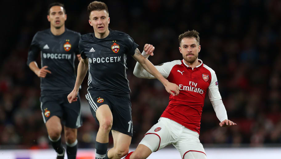 LONDON, ENGLAND - APRIL 05:  Aaron Ramsey of Arsenal is tackled by Aleksandr Golovin of CSKA Moskva during the UEFA Europa League quarter final leg one match between Arsenal FC and CSKA Moskva at Emirates Stadium on April 5, 2018 in London, United Kingdom.  (Photo by Catherine Ivill/Getty Images)