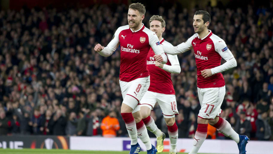 LONDON, ENGLAND - APRIL 05: Aaron Ramsey of Arsenal celebrates after scoring his team`s first goal with team mates Nacho Monreal of Arsenal and Henrikh Mkhitaryan of Arsenal during the UEFA UEFA Europa League Quarter-Final first leg match between Arsenal FC and CSKA Moskva at Emirates Stadium on April 5, 2018 in London, United Kingdom. (Photo by TF-Images/TF-Images via Getty Images)