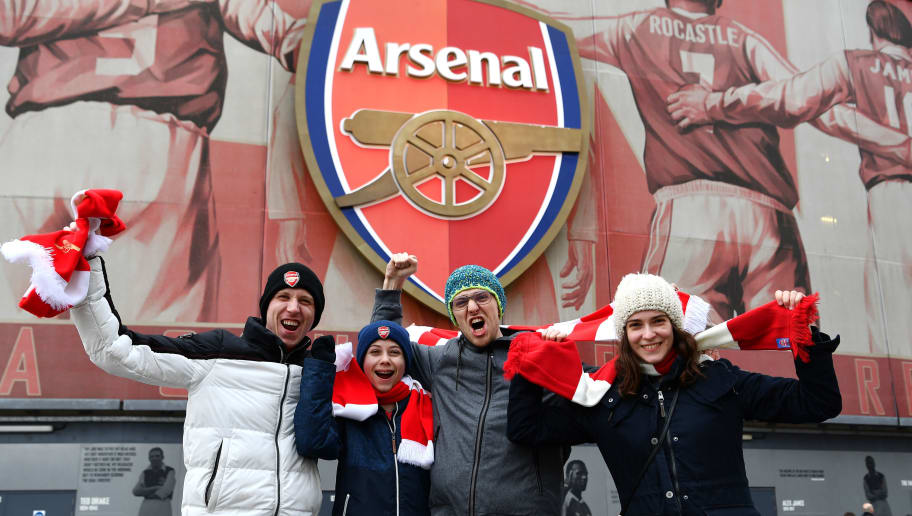 LONDON, ENGLAND - DECEMBER 08: Fans pose for a photo outside the stadium prior to the Premier League match between Arsenal FC and Huddersfield Town at Emirates Stadium on December 8, 2018 in London, United Kingdom.  (Photo by Justin Setterfield/Getty Images)