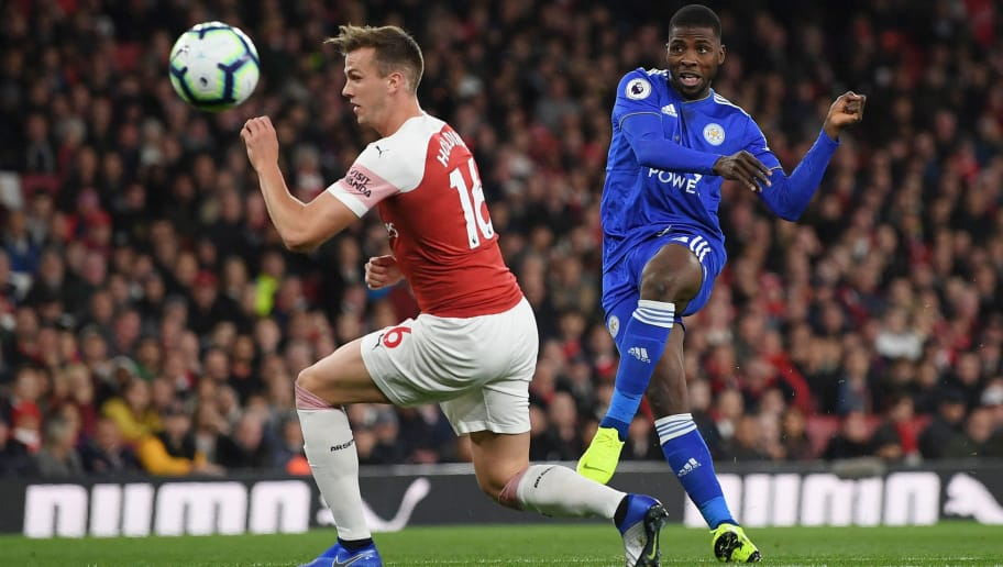 LONDON, ENGLAND - OCTOBER 22:  Kelechi Iheanacho of Leicester City kicks the ball past Rob Holding of Arsenal during the Premier League match between Arsenal FC and Leicester City at Emirates Stadium on October 22, 2018 in London, United Kingdom.  (Photo by Shaun Botterill/Getty Images)