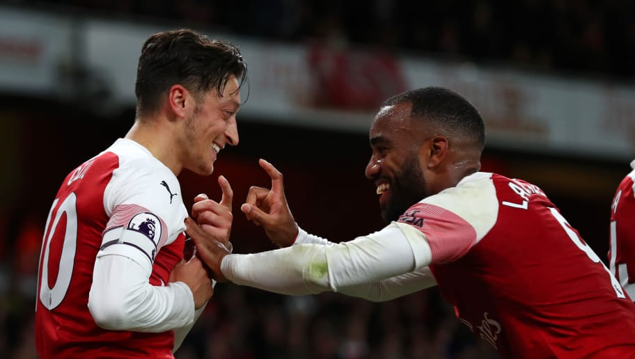 LONDON, ENGLAND - OCTOBER 22:  Mesut Ozil of Arsenal celebrates with Alexandre Lacazette of Arsenal after he scores his sides first goal during the Premier League match between Arsenal FC and Leicester City at Emirates Stadium on October 22, 2018 in London, United Kingdom.  (Photo by Clive Rose/Getty Images)