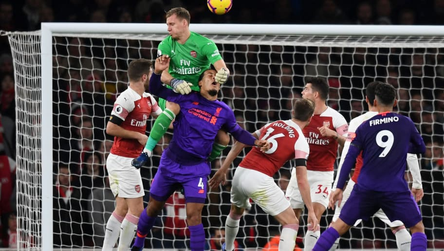 LONDON, ENGLAND - NOVEMBER 03:  Virgil van Dijk of Liverpool heads the ball and hits the post as he collides with Bernd Leno of Arsenal during the Premier League match between Arsenal FC and Liverpool FC at Emirates Stadium on November 3, 2018 in London, United Kingdom.  (Photo by Michael Regan/Getty Images)