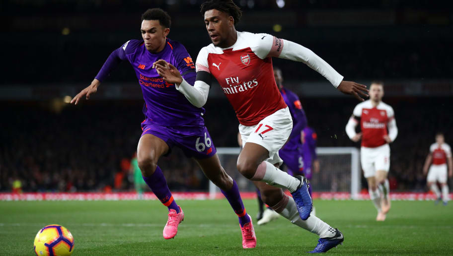 LONDON, ENGLAND - NOVEMBER 03:  Trent Alexander-Arnold of Liverpool battles for possession with Alex Iwobi of Arsenal during the Premier League match between Arsenal FC and Liverpool FC at Emirates Stadium on November 3, 2018 in London, United Kingdom.  (Photo by Julian Finney/Getty Images)