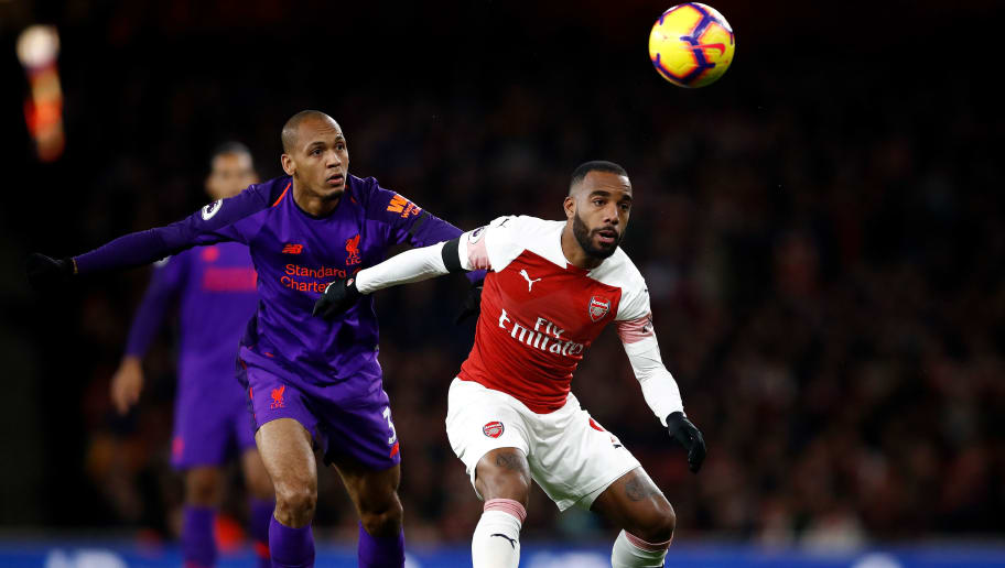LONDON, ENGLAND - NOVEMBER 03:  Alexandre Lacazette of Arsenal holds off Fabinho of Liverpool during the Premier League match between Arsenal FC and Liverpool FC at Emirates Stadium on November 3, 2018 in London, United Kingdom.  (Photo by Julian Finney/Getty Images)