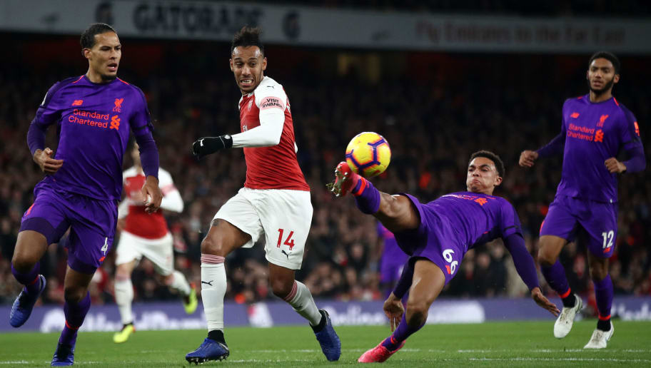 LONDON, ENGLAND - NOVEMBER 03:  Trent Alexander-Arnold of Liverpool (on the ground) controls the ball as Virgil van Dijk of Liverpool, Pierre-Emerick Aubameyang of Arsenal and Joe Gomez of Liverpool look on during the Premier League match between Arsenal FC and Liverpool FC at Emirates Stadium on November 3, 2018 in London, United Kingdom.  (Photo by Julian Finney/Getty Images)