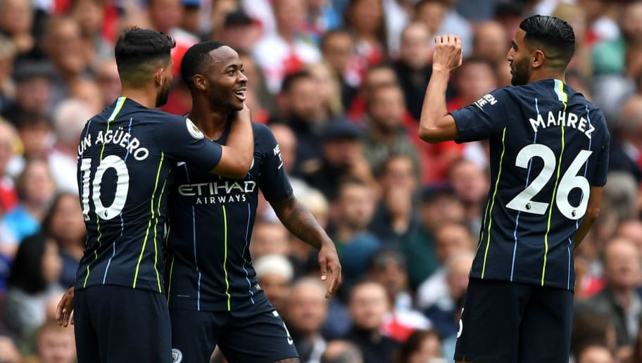 LONDON, ENGLAND - AUGUST 12:  Raheem Sterling of Manchester City celebrates after scoring his team's first goal with Sergio Aguero and Riyad Mahrez during the Premier League match between Arsenal FC and Manchester City at Emirates Stadium on August 12, 2018 in London, United Kingdom.  (Photo by Shaun Botterill/Getty Images)