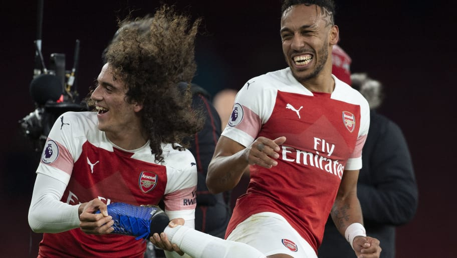 LONDON, ENGLAND - DECEMBER 02: Matteo Guendouzi and Pierre-Emerick Aubameyang of Arsenal celebrates victory after winning the Premier League match between Arsenal FC and Tottenham Hotspur FC at the Emirates Stadium on December 2, 2018 in London, United Kingdom. (Photo by Visionhaus/Getty Images)