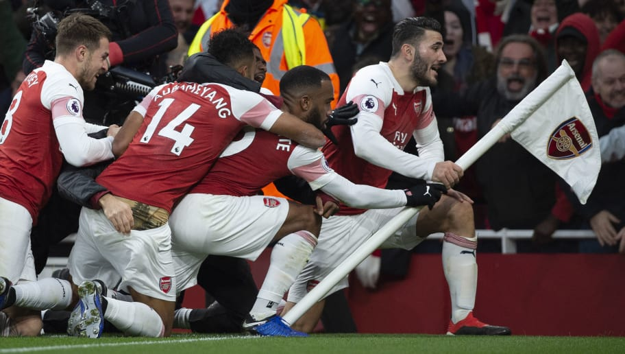 LONDON, ENGLAND - DECEMBER 02: Arsenal's Alexandre Lacazette (second right) celebrates his goal with Pierre-Emerick Aubameyang, Sead Kolasinac and Aaron Ramsey during the Premier League match between Arsenal FC and Tottenham Hotspur FC at the Emirates Stadium on December 2, 2018 in London, United Kingdom. (Photo by Visionhaus/Getty Images)