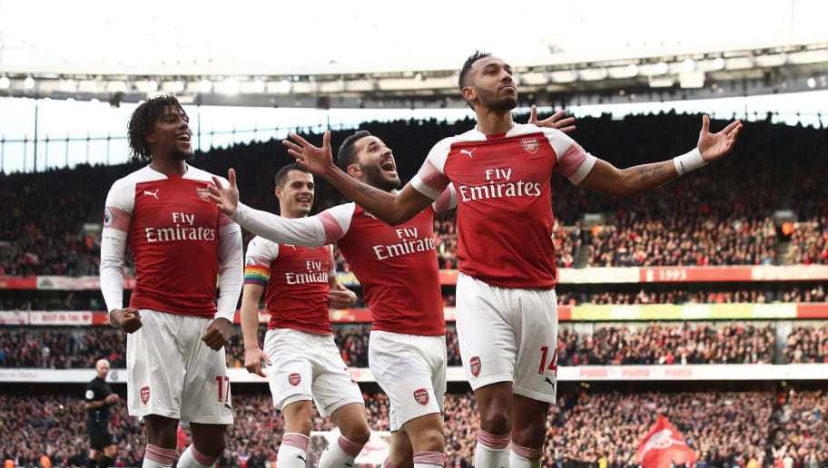 LONDON, ENGLAND - DECEMBER 02:   Pierre-Emerick Aubameyang of Arsenal celebrates scoring from the penalty spot during the Premier League match between Arsenal FC and Tottenham Hotspur at Emirates Stadium on December 1, 2018 in London, United Kingdom. (Photo by Julian Finney/Getty Images)