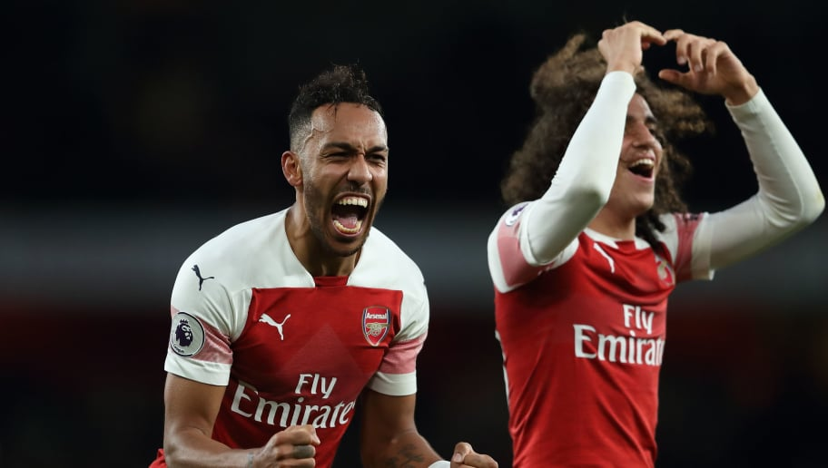 LONDON, ENGLAND - DECEMBER 02: Pierre-Emerick Aubameyang of Arsenal and Matteo Guendouzi of Arsenal celebrate their 4-2 victory over Tottenham at full time of the Premier League match between Arsenal FC and Tottenham Hotspur at Emirates Stadium on December 2, 2018 in London, United Kingdom. (Photo by James Williamson - AMA/Getty Images)