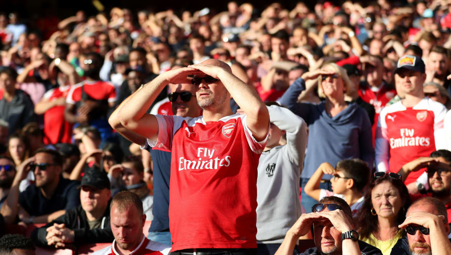 LONDON, ENGLAND - SEPTEMBER 29: Arsenal fans shield their eyes from the sun during the Premier League match between Arsenal FC and Watford FC at Emirates Stadium on September 29, 2018 in London, United Kingdom. (Photo by Catherine Ivill/Getty Images)